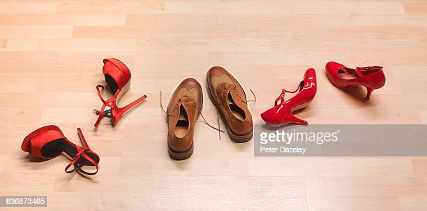 Threesome shoes on bedroom floor