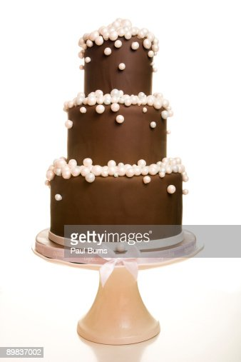 Three-Teired Chocolate Wedding Cake With Pearls : Stock Photo