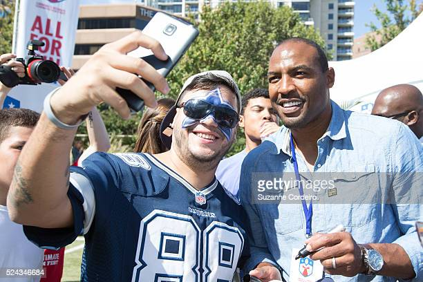 Threetime Dallas Cowboys Super Bowl champion Darren Woodson takes selfies with fans during at Carnival's Ultimate Cowboys Fan Fest on October 18 2015...