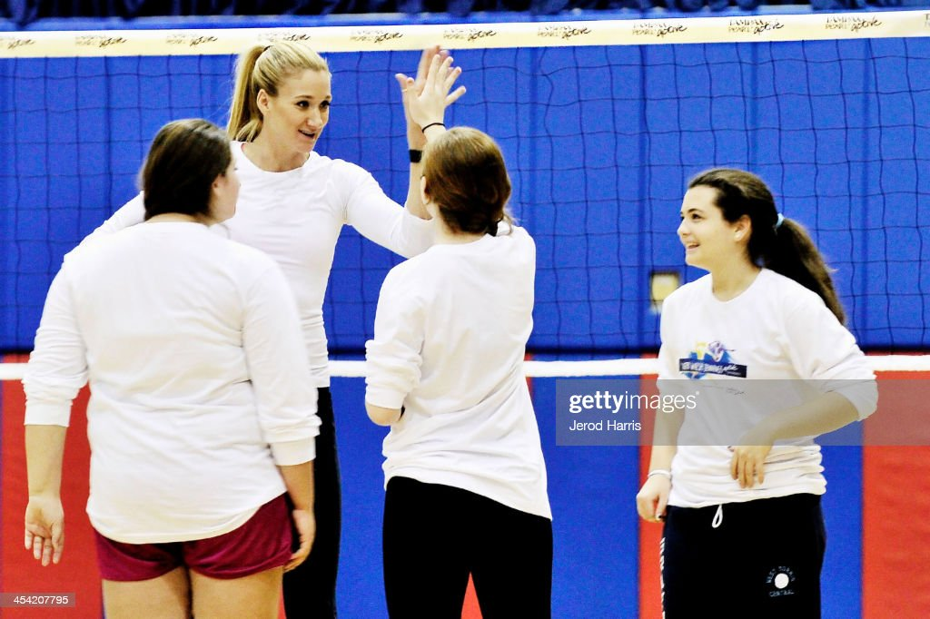 Three-time gold medalist Kerri Walsh Jennings made the day of three girls who won Tampax Pearl Active's Awesomely Active Experience on December 7, 2013 in Manhattan Beach, California.