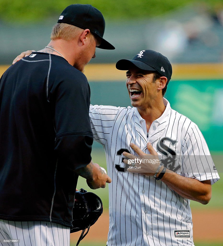 Three-time Indy 500 winner and Season 5 'Dancing with the Stars' champ Helio Castroneves laughs as he talks with <a gi-track='captionPersonalityLinkClicked' href=/galleries/search?phrase=Mat+Latos&family=editorial&specificpeople=5743563 ng-click='$event.stopPropagation()'>Mat Latos</a> #38 of the Chicago White Sox after throwing out a first pitch before the game between the Chicago White Sox and the Cleveland Indians at U.S. Cellular Field on May 24, 2016 in Chicago, Illinois.
