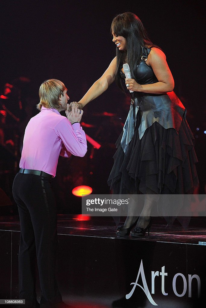 Three-time World Champion and Olympic Gold Medalist Figure Skater Evgeni Plushenko is congratulated by Donna Summer during Art On Ice at Hallenstadion on February 3, 2011 in Zurich, Switzerland.