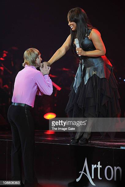 Threetime World Champion and Olympic Gold Medalist Figure Skater Evgeni Plushenko is congratulated by Donna Summer during Art On Ice at Hallenstadion...