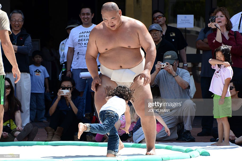 "Three-time World Sumo champion Byamba shares his knowledge with kids during the children's day LA Bloom at Little Tokio in Los Angeles, California on May 05, 2012. Bayamba was teaching kids the basic excercises and movements of Sumo and explaining their cultural significance. Mongolian-born Byambajav Ulambayar competed in sports since he was a child. By age 15, ""Byamba"" had captured national junior champion titles in judo, sambo, and Mongolian wrestling. At that time, he was invited to join professional Sumo team in Japan. At age 21, Byamba was invited to perform sumo in the film ""Oceans 13"". Since acting in 'Oceans 13', Byamba had performed in over 120 TV shows, films, commercials, and live events, all over the world. In just four years, he has traveled abroad over 50 times for his performances, and all over the United States. Some of his significant projects include being the mascot and face of Subaru Canada for the past three years, competing on 'America's Got Talent', spending a week on 'Gran Hermano' (Big Brother), with rave reviews, in Spain, performing sumo to packed arenas in India, and much more."