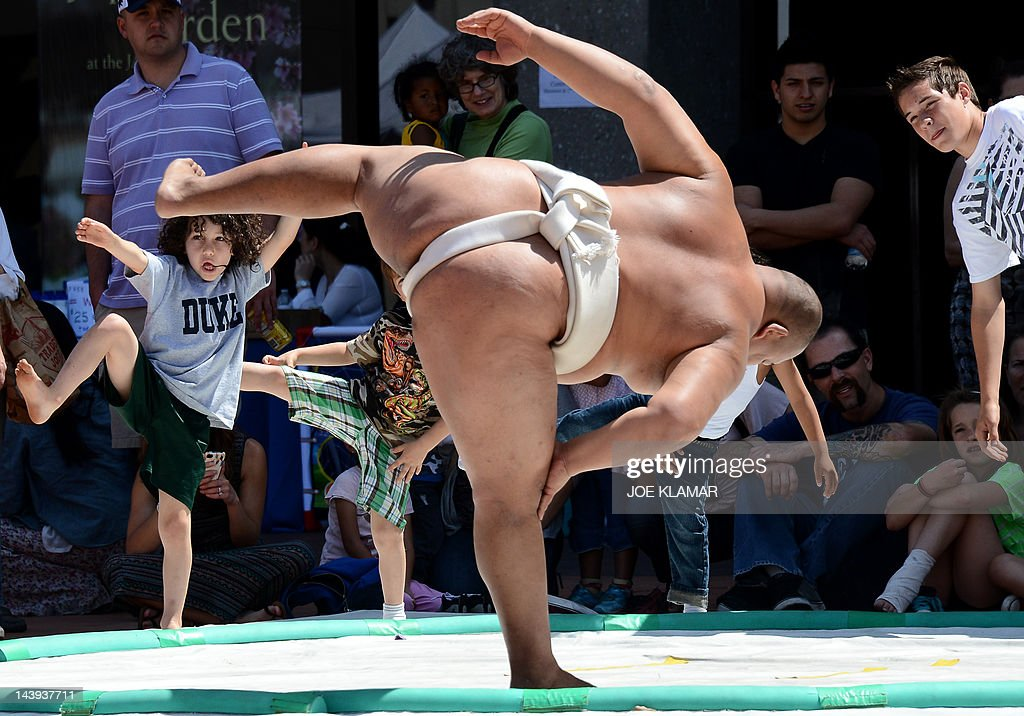 """Three-time World Sumo champion Byamba shares his knowledge with kids during the children's day LA Bloom at Little Tokio in Los Angeles, California on May 05, 2012. Bayamba was teaching kids the basic excercises and movements of Sumo and explaining their cultural significance. Mongolian-born Byambajav Ulambayar competed in sports since he was a child. By age 15, """"Byamba"""" had captured national junior champion titles in judo, sambo, and Mongolian wrestling. At that time, he was invited to join professional Sumo team in Japan. At age 21, Byamba was invited to perform sumo in the film """"Oceans 13"""". Since acting in 'Oceans 13', Byamba had performed in over 120 TV shows, films, commercials, and live events, all over the world. In just four years, he has traveled abroad over 50 times for his performances, and all over the United States. Some of his significant projects include being the mascot and face of Subaru Canada for the past three years, competing on 'America's Got Talent', spending a week on 'Gran Hermano' (Big Brother), with rave reviews, in Spain, performing sumo to packed arenas in India, and much more."""