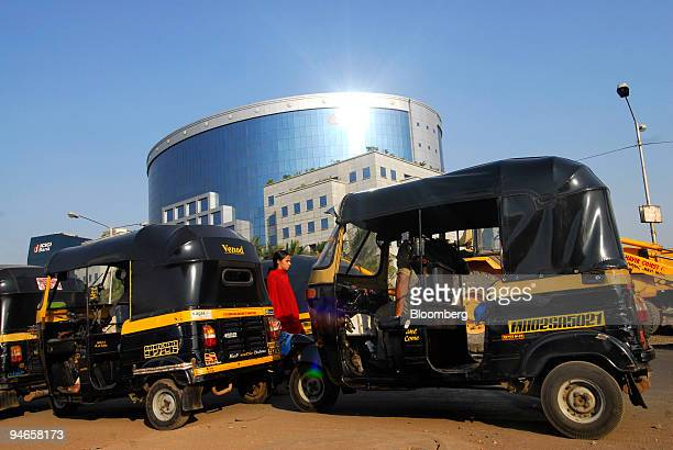 Threewheeled autorickshaws are parked near the ILFS building one of India's leading infrastructuredevelopment and finance companies in Mumbai India...