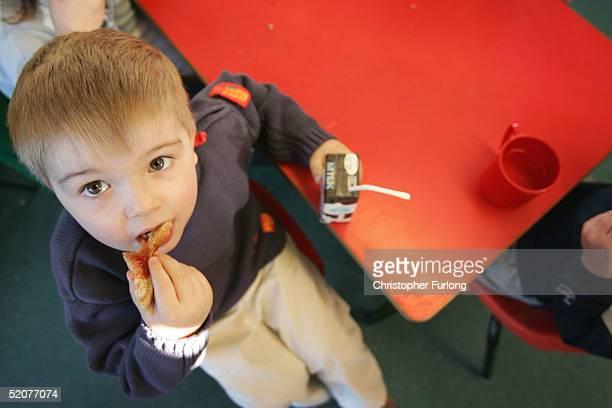 A threeyearold boy eats a sandwich at a private nursery school January 28 2005 in Glasgow Scotland The average price of preschool care has increased...