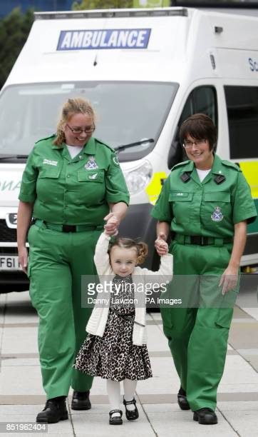 Threeyearold Casey McLean with June Maxwell and Julie Grainger two of the paramedics who saved her life after she went into cardio /respiratory...