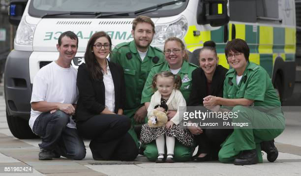 Threeyearold Casey McLean with paramedics Andy Houston June Maxwell and Julie Grainger father Malcolm McLean mother Audray Martin and emergency...