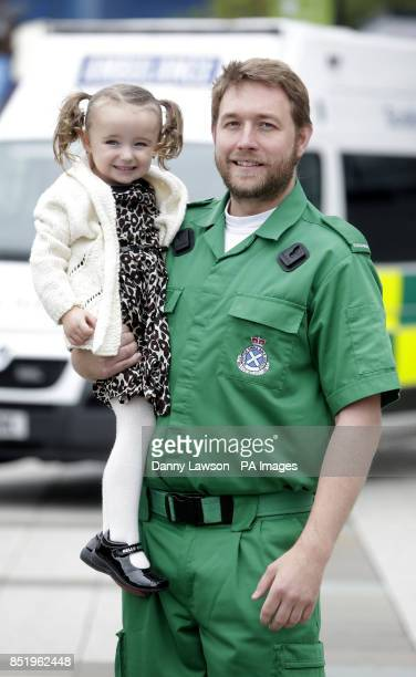 Threeyearold Casey McLean with paramedics Andy Houston one of the paramedics who saved her life after she went into cardio /respiratory arrest in...