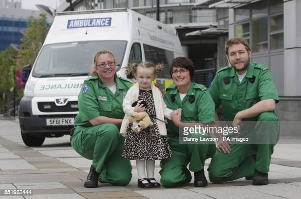 Threeyearold Casey McLean with paramedics left to right Andy Houston June Maxwell and Julie Grainger who saved her life after she went into cardio...