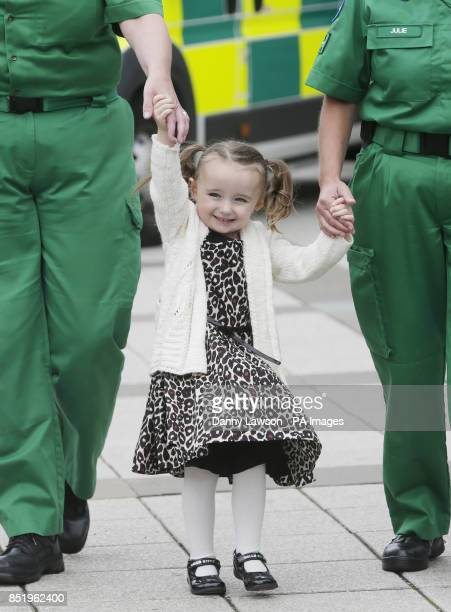 Threeyearold Casey McLean with the paramedics who saved her life after she went into cardio /respiratory arrest in Glasgow PRESS ASSOCIATION Photo...