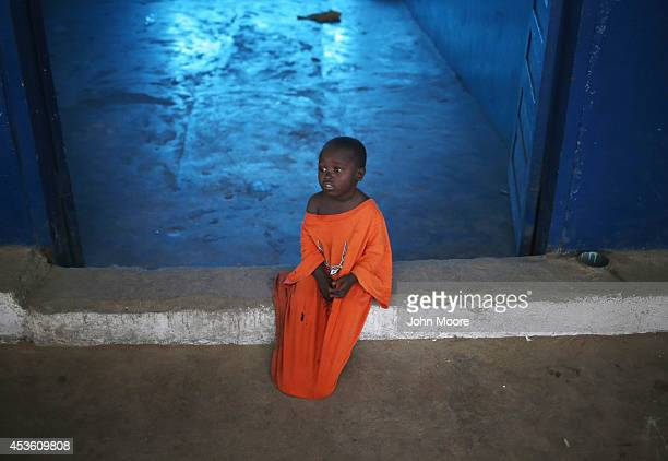 Threeyearold Nino sits in a newlyopened Ebola isolation center set up by the Liberian health ministry in a closed school on August 14 2014 in...