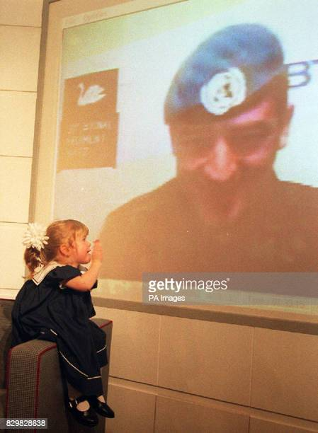 LONDON 201294 Threeyearold Rachel Birch talks to her father Corporal Birch Household Cavalry Regiment via a BT desktop videoconference terminal at...
