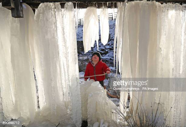 Threeyearold Reuben looks at a wall of icicles at Killhope mine in County Durham as Britain had its coldest night of the year with vast swathes of...