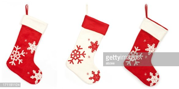 Thress Christmas stockings with shadow on white background