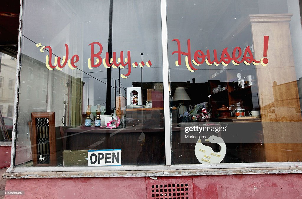 A thrift shop with a sign reading 'We Buy Houses!' is seen on March 4, 2012 in Lima, Ohio. A census report released in 2011 showed that 15.3 percent of Ohioans live in poverty, the highest rate in the state in more than 30 years. Economic conditions are a major concern among voters in the state. The Republican Party continues the process of determining who will be their general election candidate against President Barack Obama in the fall with the upcoming Super Tuesday vote.