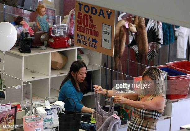 Thrift Town customer prepares to pay for her merchandise October 14 2008 in San Francisco California As the economy continues to falter thrift stores...