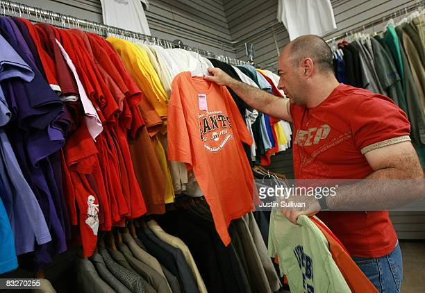 Thrift Town customer shops for tshirts October 14 2008 in San Francisco California As the economy continues to falter thrift stores are seeing a...