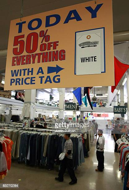 Thrift Town customers shop for clothes October 14 2008 in San Francisco California As the economy continues to falter thrift stores are seeing a...