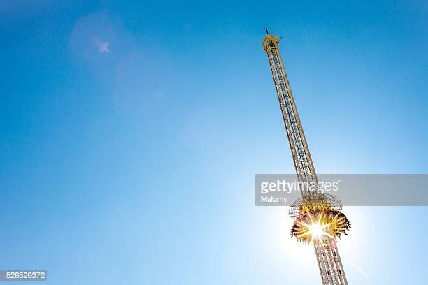 Thrill Ride. Yellow Free Fall Tower And Blue Sky