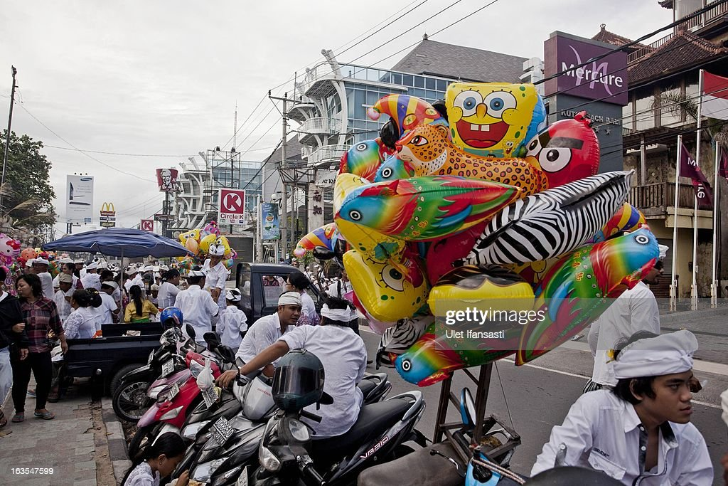 A thriving and active Kuta Beach street three days ahead of 'Silence Day' on March 9, 2013 in Denpasar, Bali, Indonesia. Nyepi means 'Day of Silence' and is observed every new year according to the Balinese calendar. The Hindu celebration is one of self-reflection and meditation and activities such as working, watching television or travelling are restricted between the hours of 6am and 6pm. Streets are deserted during these hours occupied only by the 'Pecalang', the security team in place to monitor that the restrictions are being followed.