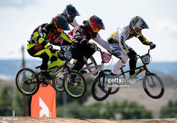 Throdwn's Cole Tesar Gordy's Bicycles' Layne Gainer and Factory Rift's Walker Finch fly into the first straight during A Pro action at the USA BMX...