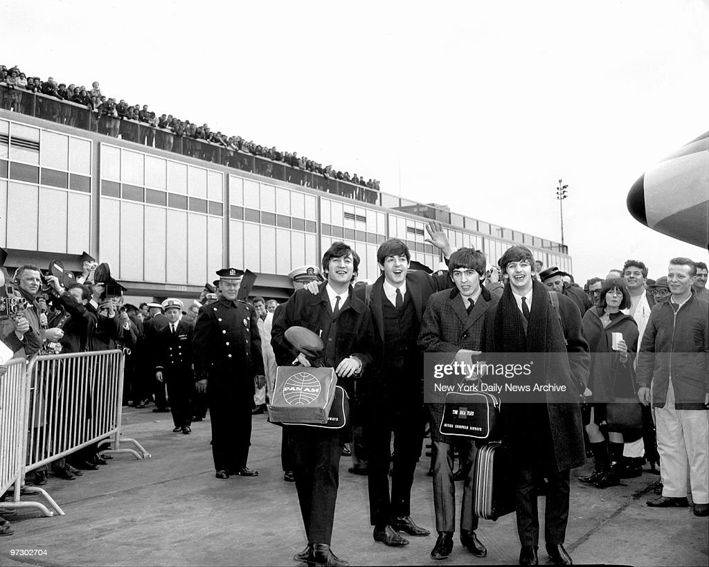 Throng is on hand to greet the Beatles as they stepped triumphantly from plane at Kennedy Airport for the first time from London for a 10-day tour.