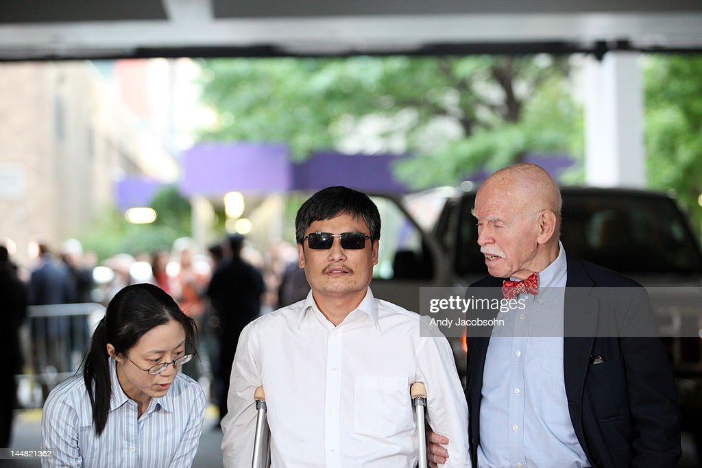 Through a translator Chinese activist Chen Guangcheng makes remarks to the media while standing beside NYU professor Jemore Cohen upon arriving on...