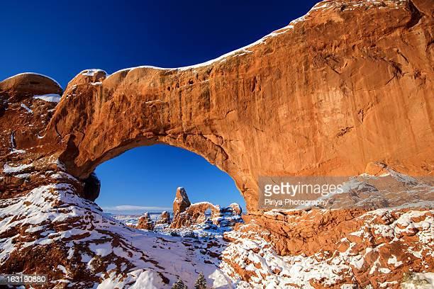 Through a window arch