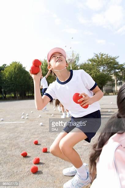 Throwing balls into basket