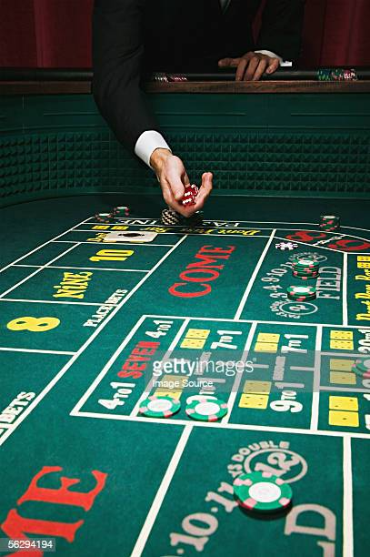 Throwing dice at a craps table
