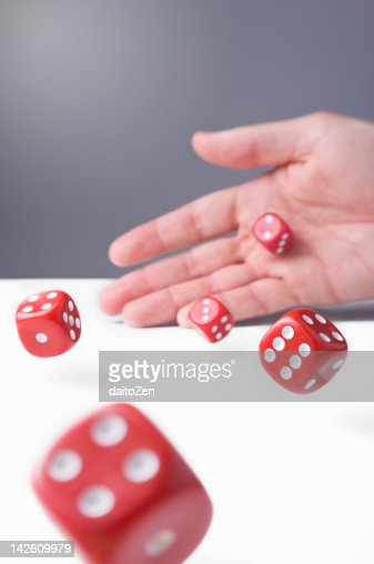 Throwing dices : Stock Photo