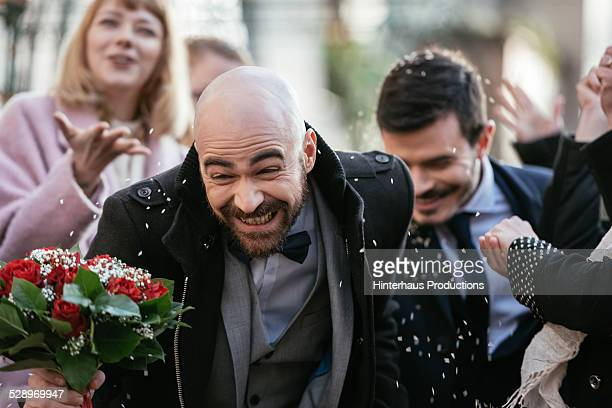 Throwing Rice On Gay Couple After Wedding Ceremony