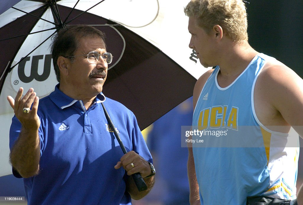 UCLA throws coach Art Venegas talks with Dan Ames during the hammer competition at the USCUCLA track and field dual meet at Drake Stadium on Friday...