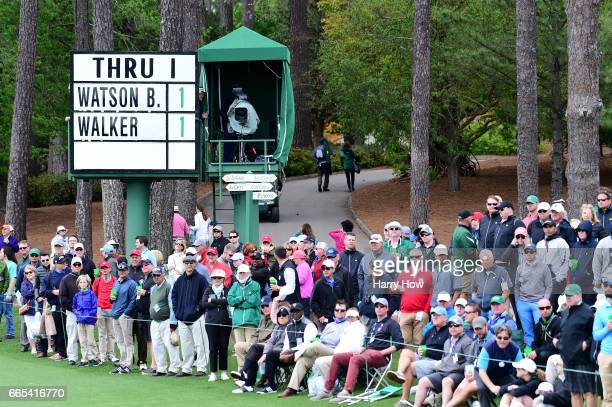 A thru board is seen near the second hole fairway as patrons look on during the first round of the 2017 Masters Tournament at Augusta National Golf...