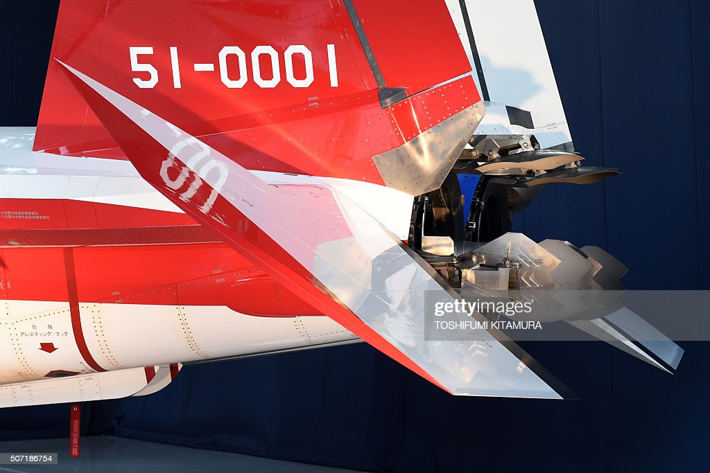 Thrust deflection paddles are seen on the exhaust nozzles of the X2 advanced technological demonstrator airplane for the Japanese Air Self Defence...