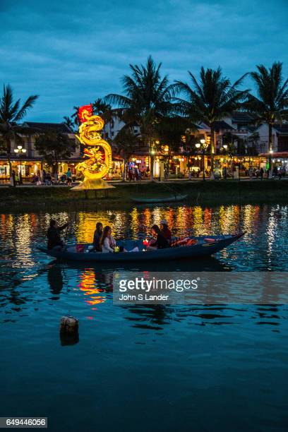 Thu Bon River at Night Reflecting Hoi An Architecture together with the Chinese and Vietnamese architectural gems 19th century French colonial stucco...