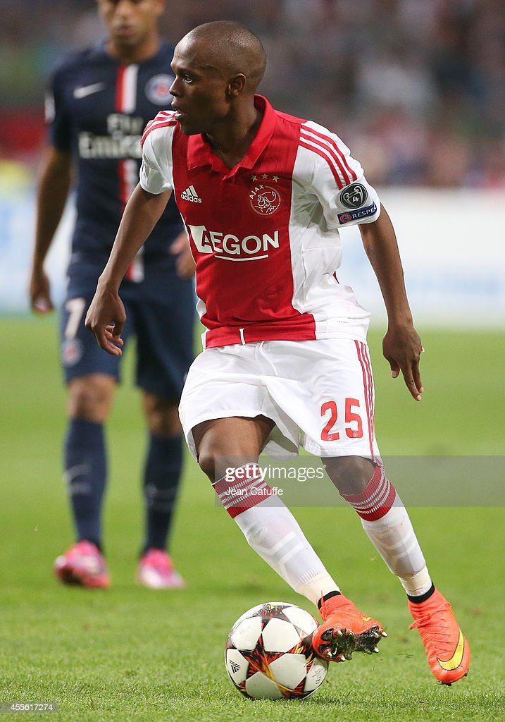 <a gi-track='captionPersonalityLinkClicked' href=/galleries/search?phrase=Thulani+Serero&family=editorial&specificpeople=6234374 ng-click='$event.stopPropagation()'>Thulani Serero</a> of Ajax Amsterdam in action during the UEFA Champions League Group F match between AFC Ajax Amsterdam and Paris Saint-Germain FC at the Amsterdam ArenA on September 17, 2014 in Amsterdam, Netherlands.