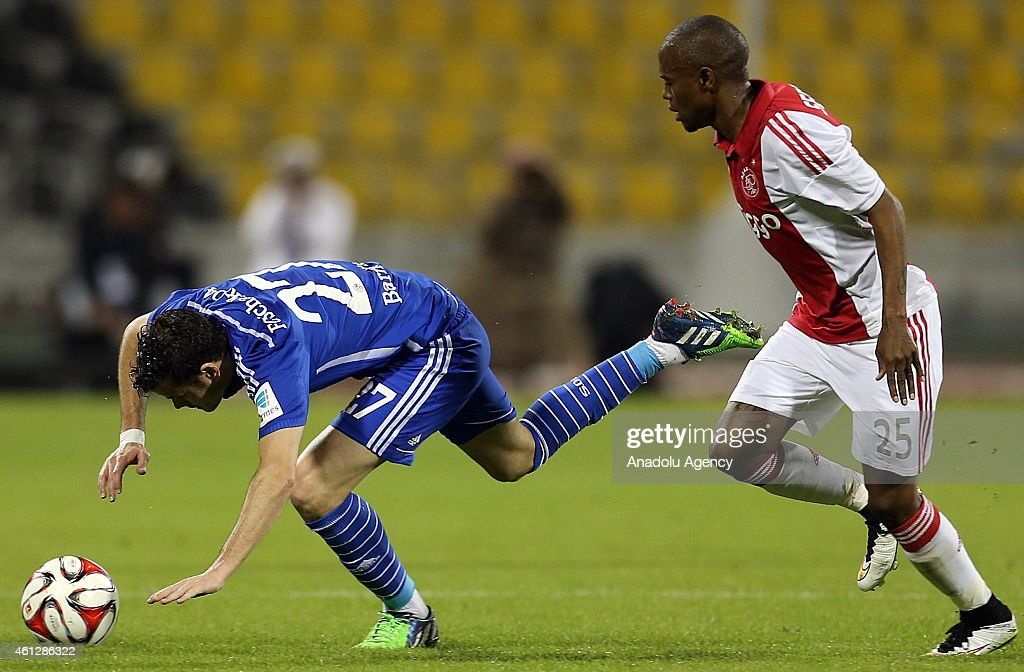 <a gi-track='captionPersonalityLinkClicked' href=/galleries/search?phrase=Thulani+Serero&family=editorial&specificpeople=6234374 ng-click='$event.stopPropagation()'>Thulani Serero</a> (R) of Ajax Amsterdam vies with <a gi-track='captionPersonalityLinkClicked' href=/galleries/search?phrase=Tranquillo+Barnetta&family=editorial&specificpeople=534444 ng-click='$event.stopPropagation()'>Tranquillo Barnetta</a> (L) Schalke 04 during the international friendly soccer match between FC Schalke 04 and Ajax Amsterdam at Qatar Sport Club Stadium in Doha, Qatar on January 10, 2015.