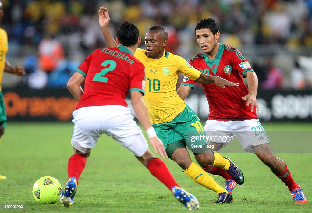 Thulani Serero of South Africa looks to get past Abderrahim Achchakir of Morocco during the 2013 African Cup of Nations match between Morocco and South Africa at Moses Mahbida Stadium on January 27, 2013 in Durban, South Africa.