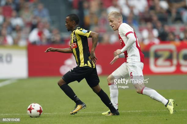 Thulani Serero of Vitesse Donny van de Beek of Ajax during the Dutch Eredivisie match between Ajax Amsterdam and Vitesse Arnhem at the Amsterdam...