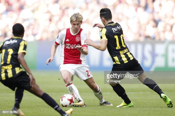Thulani Serero of Vitesse Frenkie de Jong of Ajax Thomas Bruns of Vitesse during the Dutch Eredivisie match between Ajax Amsterdam and Vitesse Arnhem...