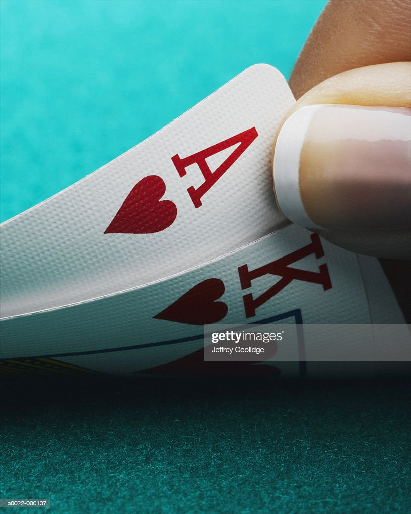 Thumb and Playing Cards : Stock Photo