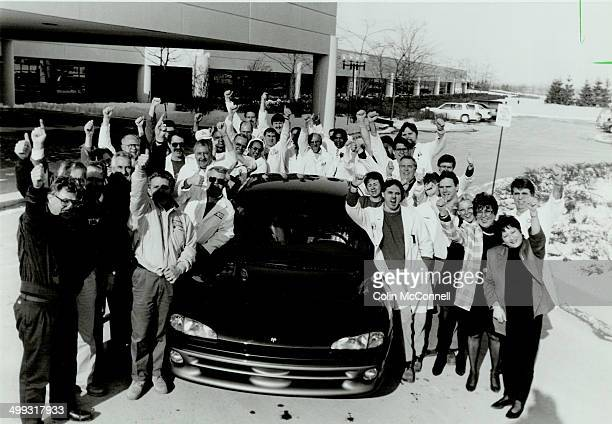 Thumbs' up favorite Showing off one sedan the Chrysler intrepid in its Car of the Year lineup yesterday are representatives from every area of...