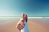 Thumbs up for sunny beach