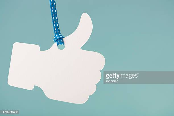 Thumbs up  hanging from cord