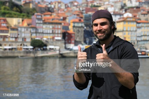 Thumbs Up Man Tourist in City of Porto, Portugal