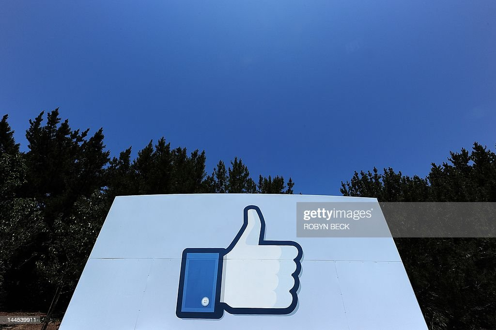 A thumbs up or 'Like' icon at the Facebook main campus in Menlo Park, California, May 15, 2012. Facebook, the world's most popular internet social network, expects to raise USD $12.1 billion in what will be Silicon Valley's largest-ever initial public offering (IPO) later this week. AFP PHOTO / ROBYN BECK