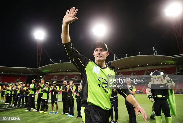 Thunder captain Michael Hussey acknowledges the crowd and walks through a guard of honour after playing his last home game after the Big Bash League...